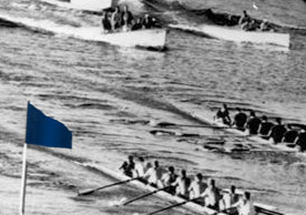 Historical photo of the Yale blue flag at rowing competitions